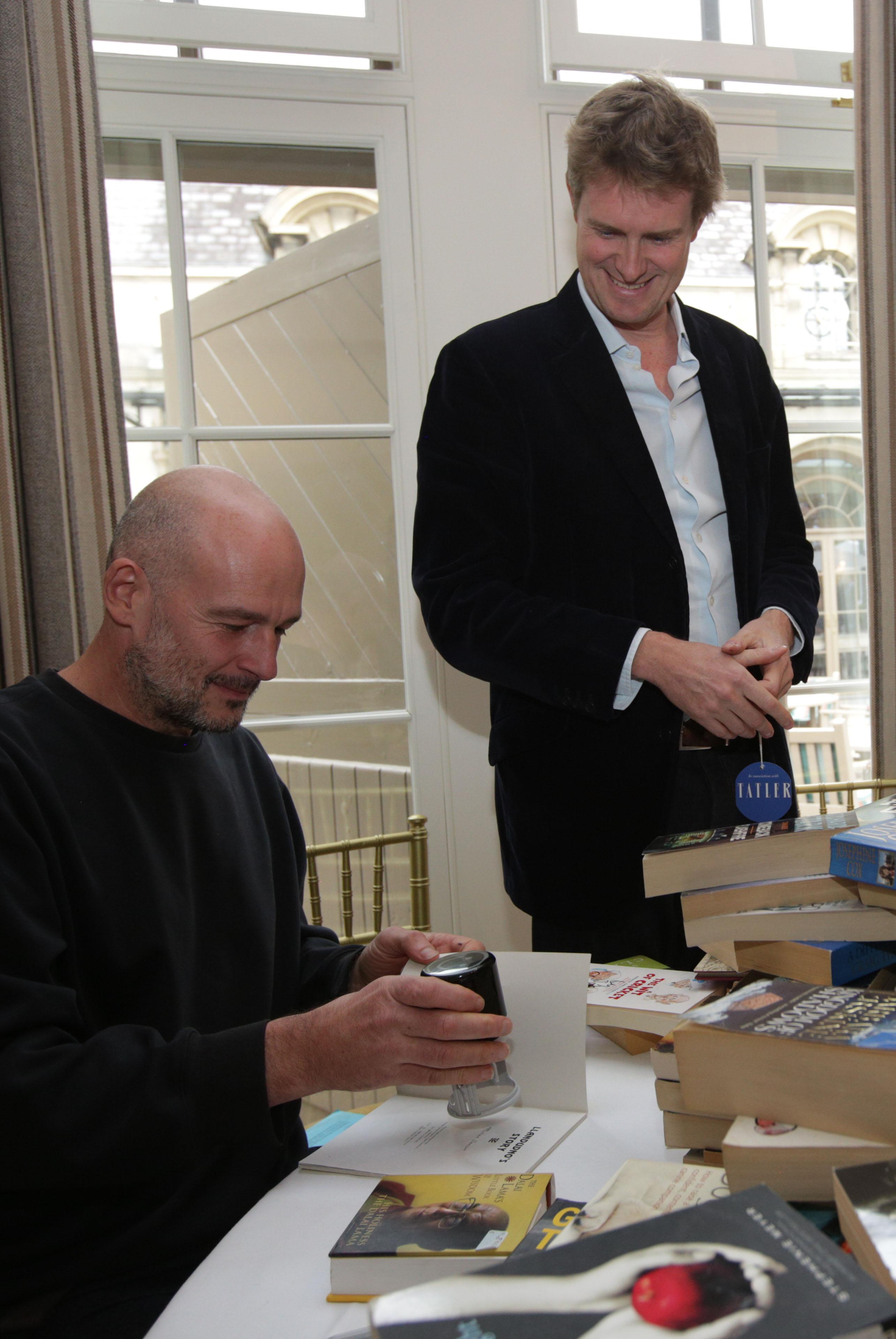 Jake Chapman signs books for Tristram Hunt at Cliveden Literary Festival