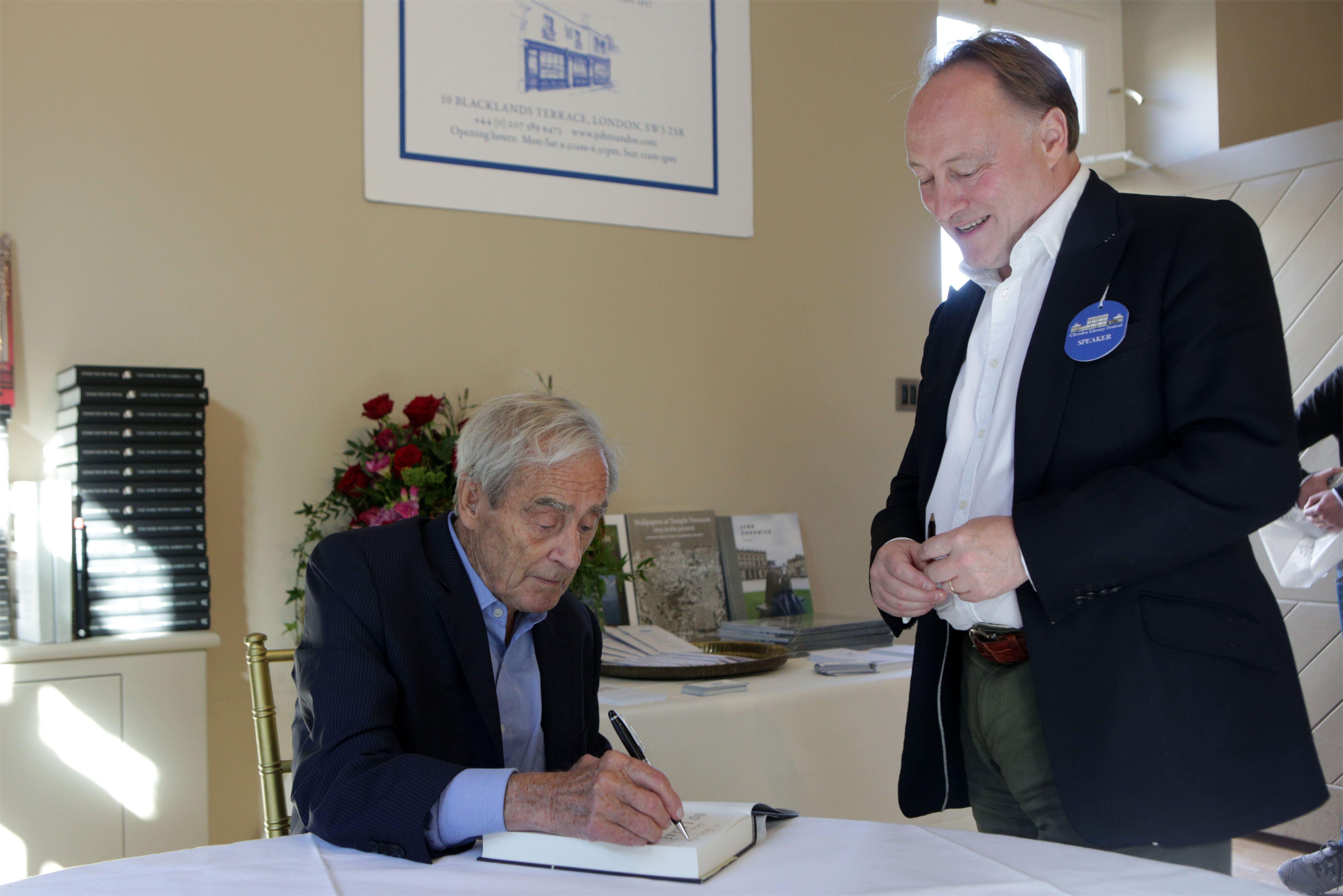 Sir Harry Evans signing his book for Cliveden Literary Festival's President Andrew Roberts